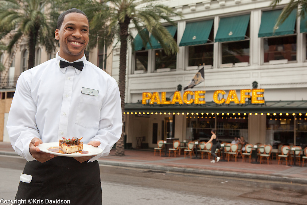 Waiter with the Crabmeat Cheesecake at Palace Cafe in New Orleans.