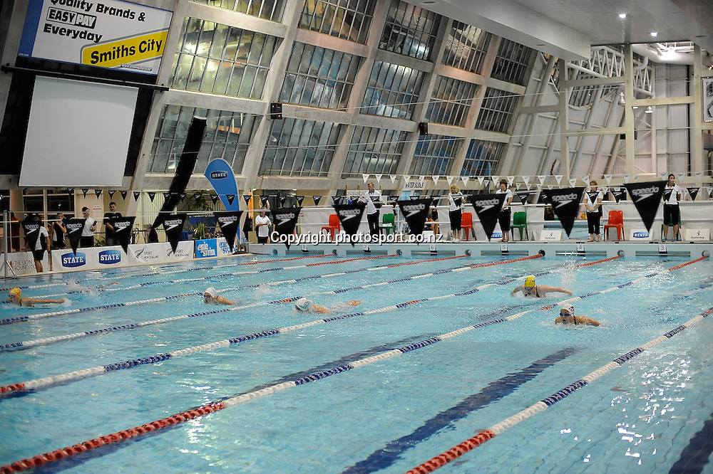 Swimmers in action, at the State New Zealand Division II Swimming Champs, at Moana pool, Dunedin, New Zealand. Friday13 April 2012. Photo: Richard Hood photosport.co.nz