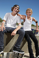Two teenage boys (16-17) with skateboards at skate park portrait
