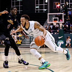 Feb 24, 2016; New Orleans, LA, USA; Tulane Green Wave guard Louis Dabney (0) drives past East Carolina Pirates guard Prince Williams (4) during the second half of a game at the Devlin Fieldhouse. Mandatory Credit: Derick E. Hingle-USA TODAY Sports