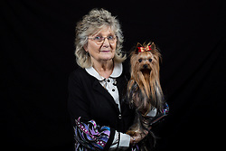© Licensed to London News Pictures. 10/03/2016. Birmingham, UK. Diana Butt with her Yorkshire Terrier named Humphrey at Crufts 2016 held at the NEC in Birmingham, West Midlands, UK. The world's largest dog show, Crufts is this year celebrating it's 125th anniversary. The annual event is organised and hosted by the Kennel Club and has been running since 1891. Photo credit : Ian Hinchliffe/LNP