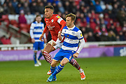 Jacob Brown of Barnsley FC and Todd Kane of Queens Park Rangers during the EFL Sky Bet Championship match between Barnsley and Queens Park Rangers at Oakwell, Barnsley, England on 14 December 2019.