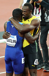 London, 2017 August 05. Usain Bolt hugs men's 100m final victor Justin Gatlin of the USA at the IAAF World Championships London 2017. © Paul Davey.