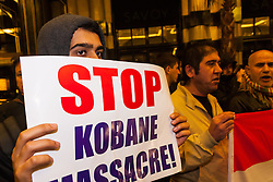 "London, October 25th 2014. Dozens of Britain's Kurdish community and their supporters demonstrated outside the exclusive Savoy as Turkey's ambassador welcomed guests to a ball. The Kurds accuse Turkey of helping Jihadists from ISIS in eradicating Kurds, who have held a long campaign for an autonomous Kurdish state. Pictured: Kurds believe that Turkey is surreptitiosly supporting ISIS in their conflict with the Kurds, and that the ""massacre"" in Kobane could be stopped by a more assertive Turkey."