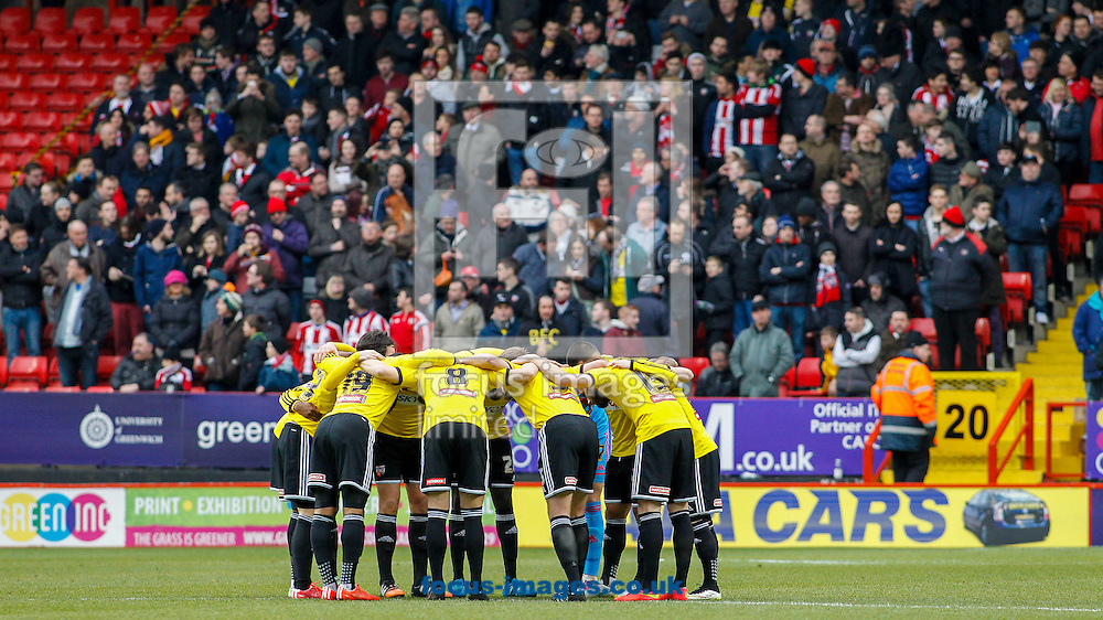 Brentfprd players huddle in front of their fans before the Sky Bet Championship match between Charlton Athletic and Brentford at The Valley, London<br /> Picture by Mark D Fuller/Focus Images Ltd +44 7774 216216<br /> 14/02/2015