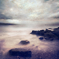 A shore with storm clouds and texture