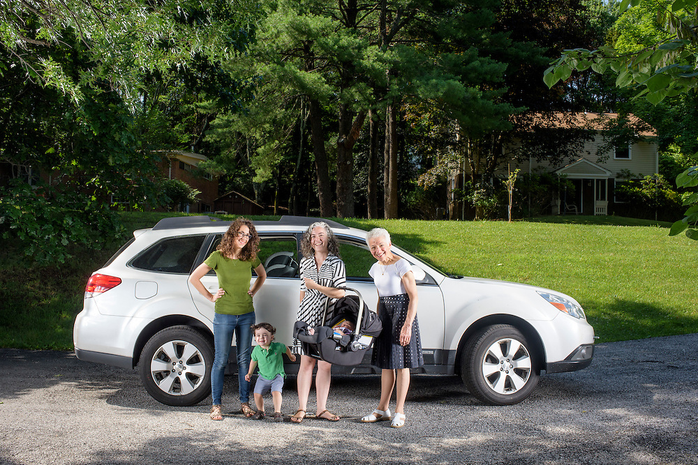 Pikesville, Maryland - June 25, 2015:  The Car Seat Ladies (L-R) Emily Levine, 34, from Manhattan, Deborah Baer, 67, from Pikesville, Maryland, and her daughter Alisa Baer, 35, also from Manhattan, hold Alisa's 7 week-old niece Leora Aghion in a Nuna Pipa infant car seat, ($300) at her sister's house in Pikesville, Maryland Thursday June 25th, 2015. Alisa's nephew Eitan Aghion, 2, joins the Car Seat Ladies.<br /> Alisa's mother, Deborah Baer, was the original Car Seat Lady who, in the 1980's, started a car seat installation class in the driveway of her home in Pikesville, Maryland for new parents. Now in her 30's Alisa, and her childhood friend Emily Levine, who also moved to Manhattan, expanded the Car Seat Lady business to New York. <br /> <br /> CREDIT: Matt Roth for The New York Times<br /> Assignment ID: 30176354A