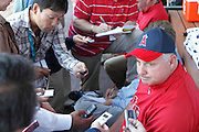 ANAHEIM, CA - APRIL  23:  Team manager Mike Scioscia #14 of the Los Angeles Angels of Anaheim talks to the media before the game between the Boston Red Sox and the Los Angeles Angels of Anaheim on Saturday, April 23, 2011 at Angel Stadium in Anaheim, California. The Red Sox won the game in a 5-0 shutout. (Photo by Paul Spinelli/MLB Photos via Getty Images) *** Local Caption *** Mike Scioscia