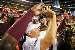Sep 3, 2017; Landover, MD, USA; Virginia Tech Hokies head coach Justin Fuente holds up the Black Diamond Championship trophy after beating the West Virginia Mountaineers at FedEx Field. Mandatory Credit: Ben Queen-USA TODAY Sports