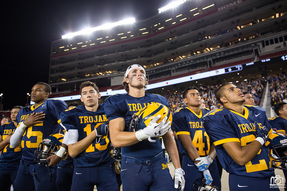 Milpitas players cover their hearts during the National Anthem before taking on Valley Christian High School during Friday Night Lights at Levi's Stadium in Santa Clara, California, on September 18, 2015.  Milpitas went on to lose 22-21 against Valley Christian.  (Stan Olszewski/SOSKIphoto)