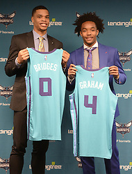 June 22, 2018 - Charlotte, NC, USA - Charlotte Hornets draft picks Miles Bridges, let, and Devonte' Graham hold up their jerseys during an introductory news conference at Spectrum Center in Charlotte, N.C., on Friday, June 22, 2018. (Credit Image: © David T. Foster Iii/TNS via ZUMA Wire)