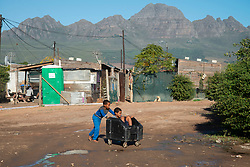Two boys play in Mountain View, an informal settlement in Jamestown, which is located in the Cape Winelands, one of the districts in the Western Cape that has been designated a hotspot area, in terms of people testing positive for COVID-19, on Saturday, May 29, 2020. When South Africa moves down to Stage 3 of the nationwide lockdown on June 1st, hotspots areas will remain under stricter regulation and surveillance, per the latest government announcements. PHOTO: EVA-LOTTA JANSSON