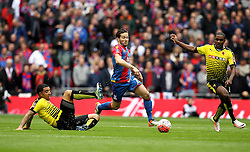 Yohan Cabaye of Crystal Palace goes past the tackle of Troy Deeney of Watford - Mandatory by-line: Robbie Stephenson/JMP - 24/04/2016 - FOOTBALL - Wembley Stadium - London, England - Crystal Palace v Watford - The Emirates FA Cup Semi-Final
