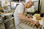 Ken Klepzig, owner of the Donut Stop on Lemay Ferry, makes apple fritters Friday March 12.