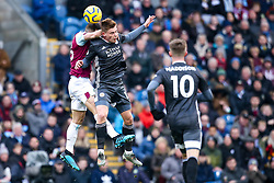 Harvey Barnes of Leicester City challenges Phillip Bardsley of Burnley to a header - Mandatory by-line: Robbie Stephenson/JMP - 19/01/2020 - FOOTBALL - Turf Moor - Burnley, England - Burnley v Leicester City - Premier League