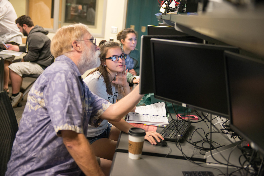 Philip Campbell, Associate Professor and Undergraduate Director for the J. Warren McClure School of Information and Telecommunication Systems, helps an incoming freshman schedule classes during Bobcat Student Orientation on  2016. © Ohio University / Photo by Kaitlin Owens