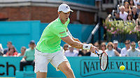 Tennis - 2019 Queen's Club Fever-Tree Championships - Day One, Monday<br /> <br /> Men's Singles, First Round: Cameron Norrie (GBR) Vs. Kevin Anderson (RSA)  <br /> <br /> Kevin Anderson (RSA) with a block on an approach to the net on Centre Court.<br />  <br /> COLORSPORT/DANIEL BEARHAM