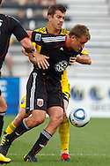 26 JUNE 2010:  Adam Cristman #7 of DC United  and Eric Brunner of the Columbus Crew (23) during MLS soccer game between DC United vs Columbus Crew at Crew Stadium in Columbus, Ohio on May 29, 2010. Galaxy defeated the Crew 2-0.