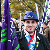London, UK - 20 October 2012: a man wearing a Unison hat poses for a picture during the TUC-organised march 'A future that works' against austerity cuts in central London.