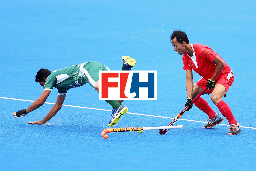 LONDON, ENGLAND - JUNE 25:  Fenghui Lu of China fouls Abu Mahmood of Pakistan during the 7th/8th place match between Pakistan and China on day nine of the Hero Hockey World League Semi-Final at Lee Valley Hockey and Tennis Centre on June 25, 2017 in London, England.  (Photo by Steve Bardens/Getty Images)