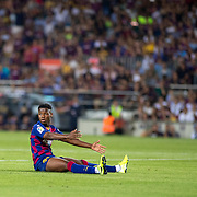 BARCELONA, SPAIN - August 25:  Anssumane Fati #31 of Barcelona reacts after not being given a free kick for a tackle by Alfonso Pedraza #6 of Real Betis on the edge of the penalty area during the Barcelona V  Real Betis, La Liga regular season match at  Estadio Camp Nou on August 25th 2019 in Barcelona, Spain. (Photo by Tim Clayton/Corbis via Getty Images)