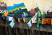 Row of colorful hand made signs.