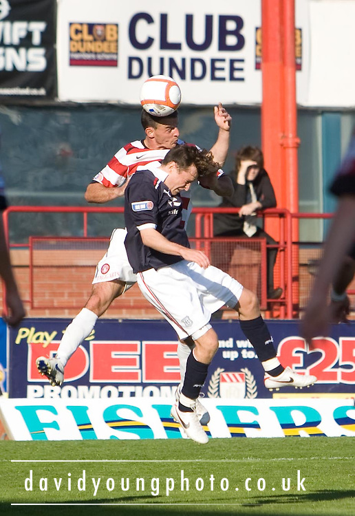 Hamilton's Derek Lyle outjumps Dundee's Nicky Riley - Dundee v Hamilton Academical - IRN BRU Scottish Football League First Division at Dens Park..© David Young.5 Foundry Place .Monifieth.DD5 4BB.07765252616.email: davidyoungphoto@gmail.com.http://www.davidyoungphoto.co.uk
