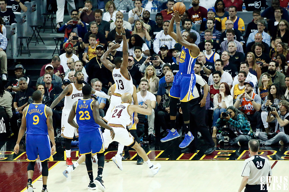 09 June 2017: Golden State Warriors forward Kevin Durant (35) takes a jump shot over Cleveland Cavaliers center Tristan Thompson (13) and Cleveland Cavaliers forward Richard Jefferson (24) during the Cleveland Cavaliers 137-11 victory over the Golden State Warriors, in game 4 of the 2017 NBA Finals, at  the Quicken Loans Arena, Cleveland, Ohio, USA.
