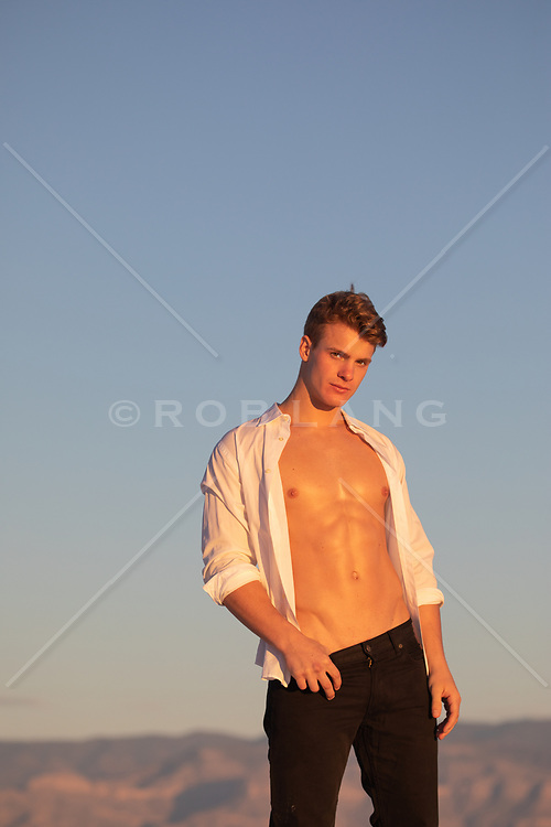 hot guy with open shirt tugging on his jeans