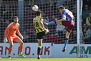 Conor Townsend of Scunthorpe United clears ball from goal area  during the Sky Bet League 1 match between Scunthorpe United and Burton Albion at Glanford Park, Scunthorpe, England on 9 April 2016. Photo by Ian Lyall.