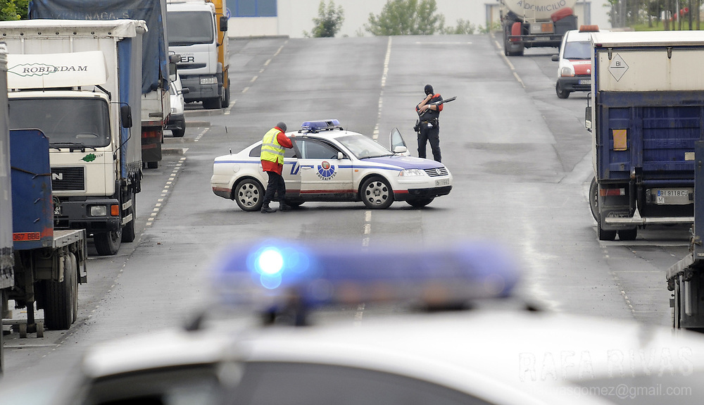 Basque police block a road next to the building of Basque journal El Correo, where separatist armed group ETA exploded off a bomb early on June 8, 2008, in the northern Spanish Basque village of Zamudio. No victims were reported.
