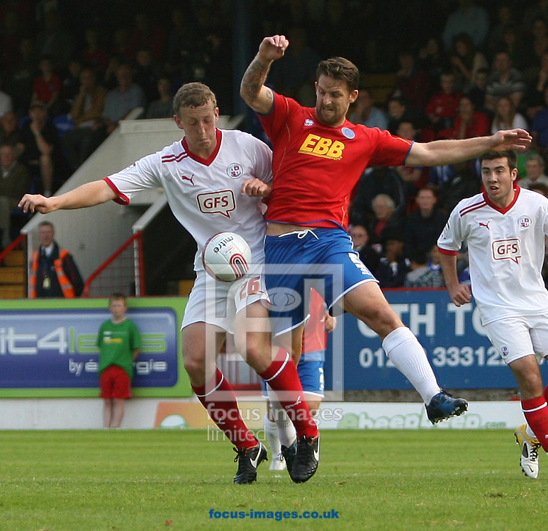 Picture by Paul Terry/Focus Images Ltd..24/9/11.Darren Jones (R) of Aldershot and Tom Eastman of Crawley during the Npower League 2 match at The Recreation Ground, Aldershot.