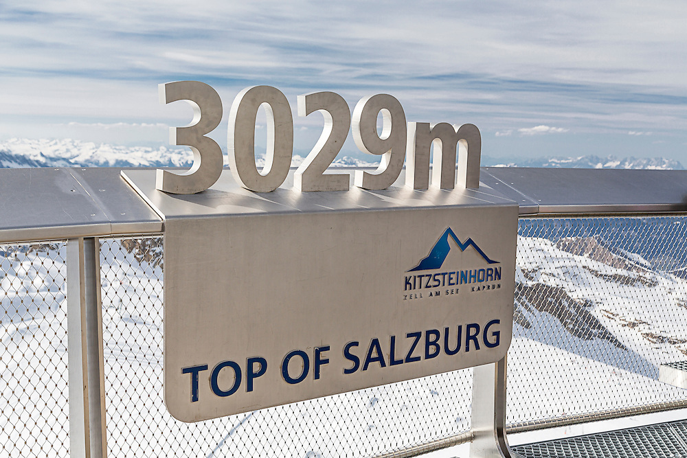A sign on the observation deck at the top of the Kitzsteinhorn mountain in the Austria Alps.  The Kitzsteinhorn is a major skiing area close to Zell Am See offering an extended skiing season due to its high altitude.It is also a major tourist destination during the summer months. The observation deck overlooks the glacier and has breathtaking views over the Alps.