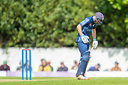 Scotland's Matthew Cross winces in pain after being hit by a fast ball during the One Day International match between Scotland and Afghanistan at The Grange Cricket Club, Edinburgh, Scotland on 10 May 2019.