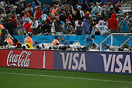 Everybody covered up as the rain comes down for the Netherlands v Argentina World Cup 2014 semi final match at the Arena Corinthians, Sao Paulo, Brazil. Photo by Andrew Tobin/Tobinators Ltd