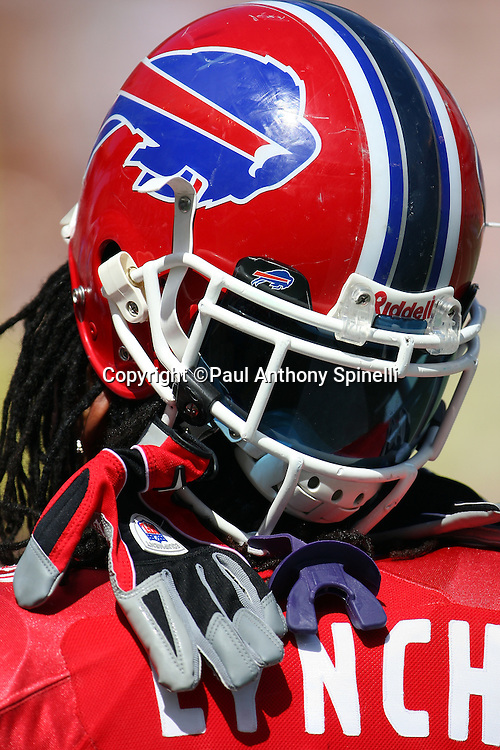 HONOLULU, HI - FEBRUARY 08: AFC All-Stars running back Marshawn Lynch #23 of the Buffalo Bills hangs his gloves off his face mask with his helmet flipped backwards during a break in the action against the NFC All-Stars in the 2009 NFL Pro Bowl at Aloha Stadium on February 8, 2009 in Honolulu, Hawaii. The NFC defeated the AFC 30-21. ©Paul Anthony Spinelli *** Local Caption *** Marshawn Lynch