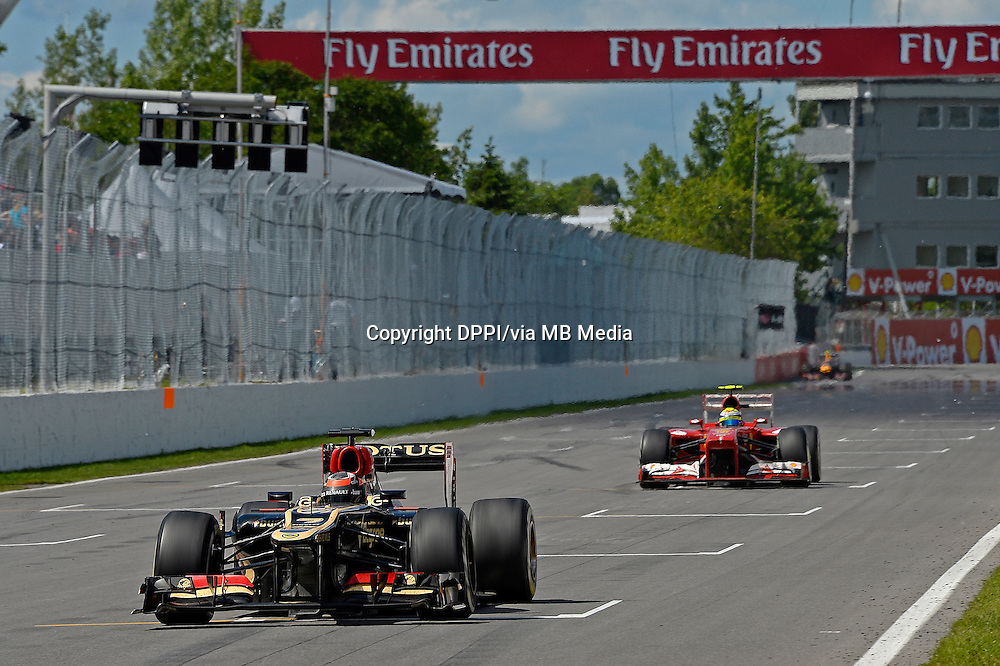 MOTORSPORT - F1 2013 - GRAND PRIX OF CANADA - MONTREAL (CAN) - 07 TO 09/06/2013 - PHOTO ERIC VARGIOLU / DPPI RAIKKONEN KIMI (FIN) - LOTUS E21 RENAULT - ACTION<br /> MASSA FELIPE (BRA) - FERRARI F138 - ACTION