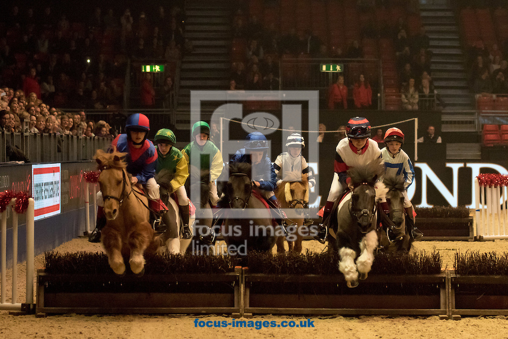 The Osborne Refrigerators Shetland Pony Grand National on Day One of the Olympia Horse Show 2015 at Olympia, London<br /> Picture by Mark Chappell/Focus Images Ltd +44 77927 63340<br /> 15/12/2015