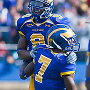 Delaware CB (#9) Anthony Walters and LB (#7) Kyle Hunte celebrate after stopping Villanova on fourth down. No.1 Delaware loses to No. 15 Villanova 28-21 on a brisk Saturday afternoon at Delaware stadium in Newark Delaware...Delaware will have to wait until Sunday 11/21/10 to receive a NCAA Tournament playoff berth.