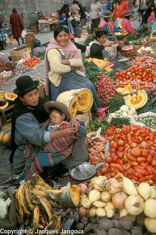 Chola women and baby at market in La Paz, Bolivia
