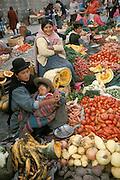 Chola women and baby at market in La Paz, Bolivia