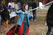 Jessica Pearson runs around the Maypole during the Oxford High School Medieval Faire at Oxford High School in Oxford, Miss. on Wednesday, November 14, 2012.