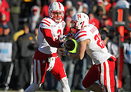 November 23 2012: Nebraska Cornhuskers quarterback Taylor Martinez (3) hands the ball off to running back Rex Burkhead (22) during the second half of the NCAA football game between the Nebraska Cornhuskers and the Iowa Hawkeyes at Kinnick Stadium in Iowa City, Iowa on Friday November 23, 2012. Nebraska defeated Iowa 13-7 in the Heroes Game on Black Friday.
