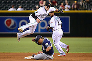 PHOENIX, AZ - JULY 05:  Nick Ahmed #13 of the Arizona Diamondbacks turns the double play over the sliding Yangervis Solarte #26 of the San Diego Padres during the third inning at Chase Field on July 5, 2016 in Phoenix, Arizona.  (Photo by Jennifer Stewart/Getty Images)