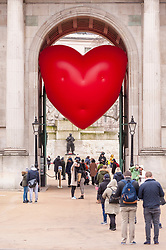 "© Licensed to London News Pictures. 14/02/2018. LONDON, UK. A giant chubby heart balloon is seen at Wellington Arch as part of ""Chubby Hearts Over London"",  a design project conceived by Anya Hindmarch.  Supported by the Mayor of London, the British Fashion Council and the City of Westminster giant chubby heart balloons will be suspended over (and sometimes squashed within) London landmarks as a declaration of love to the city starting on Valentine's Day and continuing throughout London Fashion Week.   Photo credit: Stephen Chung/LNP"