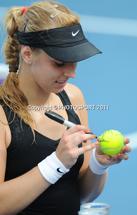 Sabine Lisicki (GER) signs tennis balls after her second round singles match against Mona Barthel (GER) at the 2012 ASB Tennis Classic at the ASB tennis centre, Stanley st. Auckland. Wednesday 4  January 2012 Photo: Andrew Cornaga/photosport.co.nz
