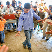 Students dance in celebration of Teacher's Day at a Kabul school.