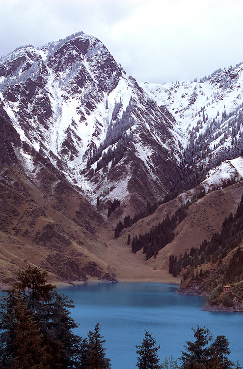 Lovely Heavenly Lake lies in the snowy shadow of the Tien Shan Range, Xinjiang, China.