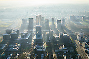 Nederland, Noord-Holland, Amsterdam, 11-12-2013; zicht op de Zuidas met in het midden Station Zuid-WTC, World Trade Centre (WTC) en Ring A10, foto richting Buitenveldert. Verder in beeld hoofdkantoor ABN-AMRO, de woontorens Symphony 1 en 2 (onderdeel Gershwin), de Vinoly-toren en Ito-toren (onderdeel Mahler4), Atrium.<br /> Zuid-as, 'South axis', financial center in the South of Amsterdam, with headquarters of former ABN AMRO. Amsterdam equivalent of 'the City', financial district. <br /> luchtfoto (toeslag op standaard tarieven);<br /> aerial photo (additional fee required);<br /> copyright foto/photo Siebe Swart.
