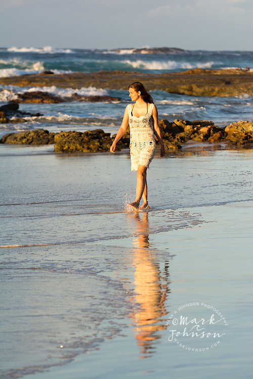Young woman in a sun dress on a beach, N. Stradbroke Island, Queensland, Australia